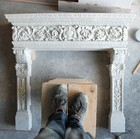 The white Carrara marble fireplace being ultimated, Frilli Gallery Marble Studio