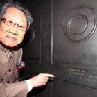 Mr. Motoyama in front of his signature engraved into immortality