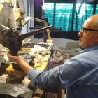 The Sculptor Silvano Porcinai is working on the wax