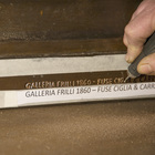 The Frilli Gallery signature chiseled at the base of the North Door replica