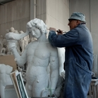 At the Marble Studio - An artisan sculpting by hand a replica of the Bacchus by Michelangelo
